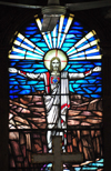 Belize City, Belize: St. John's Anglican cathedral - Christ - stained glass window and fan - photo by M.Torres