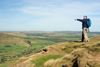 Peak District, Derbyshire, England: hiker pointing at the horizon - near Castleton - photo by I.Middleton
