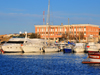 Porto Torres / P�ltu T�rra, Sassari province, Sardinia / Sardegna / Sardigna: the harbour, built over its Roman predecessor - yachts and Coast Guard building - Cormorano Marina - photo by M.Torres