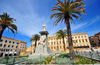 Sassari / T�thari, Sassari province, Sardinia / Sardegna / Sardigna: Piazza d' Italia - palm trees and statue of Vittorio Emanuele II, symbol of the Italian Risorgimento - Palazzo della Provincia in the background - photo by M.Torres