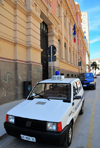 Sassari / T�thari, Sassari province, Sardinia / Sardegna / Sardigna: Via Brigata Sassari - Fiat Panda of the Municipal Police in front of the Central Post Office - Palazzo delle Poste e Telegrafi - designed by the engineer Bruno Cipelli - photo by M.Torres